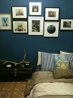 Prints adorn a blue wall at 20x200 team member Charlie's home.