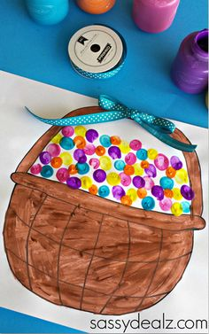 OMG! This Fingerprint Easter Basket Art is such a cute and easy Easter craft for kids to make. There's even a free printable they can use to color the Easter basket!