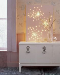 Twinkle lights behind a blank canvas -year round twinkle!