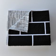 Black brick quilt: Modern minimalist monochrome by EdgeEffects