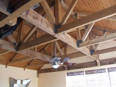 Exposed cedar trusses with stained tongue and groove ceiling...courtesy of New Era Construction in Naples Florida