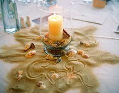 Adorable centerpiece idea for a beach themed wedding.