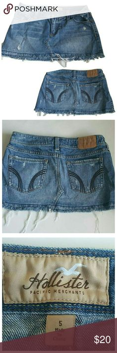 "Hollister Distressed Mini Jean Skirt - Size 5 Mini jean skirt from Hollister. Juniors size 5. Medium denim wash. Frayed hem, distressed look. 100% Cotton. 31"" Waist, 10.5"" Front Length, 11.5"" Back Length. Pre-loved, very good condition. Hollister Skirts Mini"