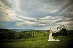 Bride with veil on mountaintop