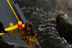 A U.S. Air Force Special Operations pararescueman gets hoisted off a ship by a U.S. Navy Petty Officer 2nd Class during Emerald Warrior 2013. (U.S. Air Force photo by Tech. Sgt. Quinton Russ)