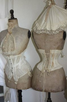 A pair of vintage dress forms.