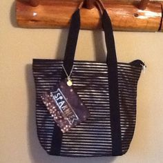 """Pretty Black & Gold Tote with Smaller Bag 16 x4. Handle is 8"""". Little bag is 6 x 4 1/2. This comes from Bath and Body Works. Fill it full of goodies and give it away or keep it for yourself. Like new!! Non smoking home Bags"""