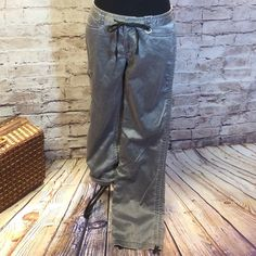 STYLISH UTILITY PANTS BY EXPRESS These are fun and stylish. Drawstring at the bottom of leg to shorten and cinch.. Pockets galore and a sheen to the fabric. ❌Note one small blemish in pic about. Not very noticeable.. Express Pants