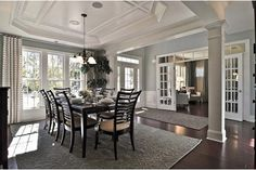 A coffered ceiling, large windows and white pillars define the sun-filled dining room of the Avalon model from Pulte Homes. The Whetstone new home community in Brentwood, TN.