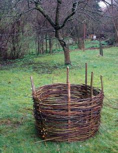 how to weave a raised flower bed, compost bin, planter cover or fence!  Straight up DIY basket-weaving!