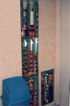 In-wall system food storage system. This is a commercial system to rotate stored or pantry food (Pharoahs Storehouse), but the idea of putting storage between wall studs is very creative if there is no room for a traditional pantry.