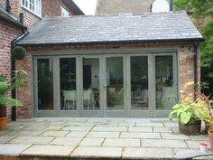Enclosed patio windows ideas for 2019 Chalet Extension, Extension Veranda, Cottage Extension, Rear Extension, Bifold Doors Extension, Brick Extension, Extension Ideas, Garden Room Extensions, House Extensions