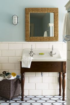 An unusual shape, size, or material can make a sink special enough for guests but ideal for family use, too. An extra-deep utility basin, such as this one, which is set into a handsome wood base, is super-functional when the powder room is also hand-washing central for kids. In fact, the twin faucets make it doubly so. | Photo: Eric Piasecki/Otto