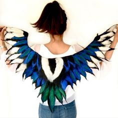 This beautifully felted Magpie winged cape is created by hand felting a blend of blues and greens, black and white Merino wool resulting in the distinctive wingspan of the Magpie. Feather Cape, Good Luck Symbols, Cosplay, Neck Wrap, Magpie, Spirit Animal, Pagan, Wearable Art, Merino Wool