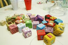 DIY Baby Shower Idea: get wood blocks and have everyone paint a block for the baby to (eventually) play with! (I still have blocks 17 years later that 5 kids (and tons of friends) have played with from my 1st baby's baby shower!!!)