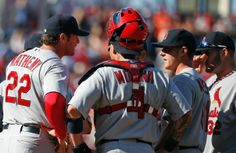 manager Mike Matheny talks with catcher Yadier Molina, relief pitcher Seth Maness, second from right, and others, during a meeting on the mound in the ninth inning of a game against the Nationals. Cards lost 3-2. 4-20-14