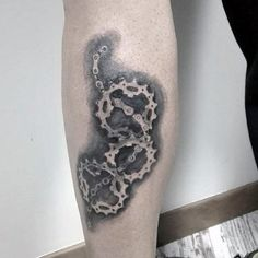 Guy With Elaborate Bicycle Gear Tattoo On Legs