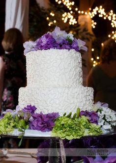 Wedding cake with purple flowers.  Raleigh weddings.