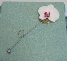 A decorative wand bridesmaid arrangement.