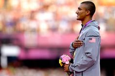 The United States' Ashton Eaton listens to the U.S. national anthem after being presented with a gold medal in the men's decathlon.