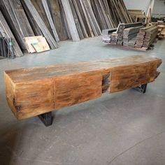 Rustic barn beam bench by barnboardstore.com - 12x12 hand hewn beam sanded and finished, then mounted on industrial look raw steel legs - available at barnboardstore.com