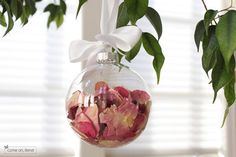 Dry the flowers from your wedding bouquet and save the petals as a holiday ornament!