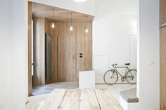 3 Vaults / R3architetti wood and white, entrance