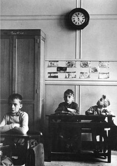 Young boys trying so hard to make it to the end of the school day, 1956