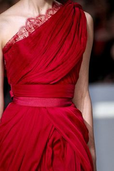 Beautiful scarlet Elie Saab gown with ribbon waist and draped, one shoulder bodice with lace edging along the neck.