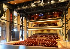 The old brickwork has been repaired, and inside the theatre's auditorium is bracketed by tall glass walls – a feature that is intended to preserve the spatial experience of the historic building.