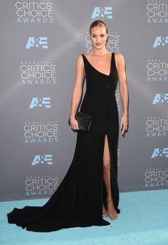 In Saint Laurent dress and clutch with Anita Ko earrings.    - ELLE.com