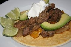 I made these super easy fajitas last week in the crock using 2 lbs skirt steak + 1 onion, 2 bell peppers & 1 pkg organic fajita seasoning and adding cumin and smoked paprika. The family loved it! Served with shredded zucchini, limes, cheese, ezekiel tortillas, lettuce & fresh bell pepper.