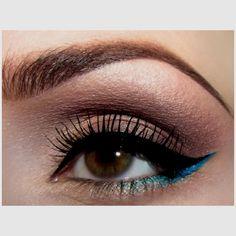 Warm rosy neutral eye with a pop of bright blue