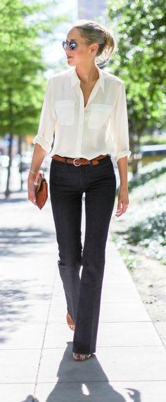 dark wash flare leg bell bottom jeans, silk ivory button front collared blouse, cognac brown braided belt, block heel mules, envelope clutch + messy bun