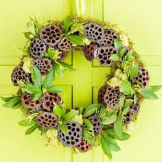 Hot-glue moss to a wreath form, covering it completely. Then add lotus pods in a random pattern to the wreath. Finish by adhering fresh or faux leaves and arborvitae sprigs to the moss around the lotus pods. Christmas Wreaths To Make, Holiday Wreaths, Christmas Crafts, Christmas Decorations, Wreaths And Garlands, Door Wreaths, Greenery Wreath, Natural Christmas, Winter Christmas