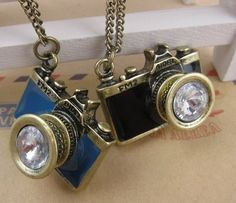 Cute #cameranecklace glazed in various colors.  These are very #popular with #photographers.  Makes an #excellentgift