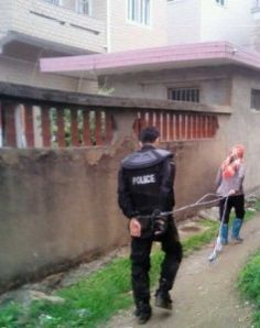 Villagers in Fujian Province took several officials hostage, including a special force police officer who was handcuffed and paraded through town.