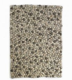 The firm yet cushy rug invites relaxation as it gently massages bare feet. Clusters of soft felted wool that duplicate water-smoothed river stones down to the finest striations. 3'x5' $495 or 5'x8' $1095 from VivaTerra catalog