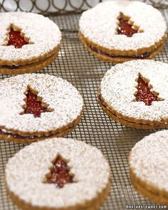 Linzer cookies also look beautiful when sandwiching a dollop of jam! We love the Christmas tree cutouts in these cookies. Noel Christmas, Christmas Goodies, Christmas Treats, Christmas Biscuits, Holiday Baking, Christmas Baking, Traditional Christmas Cookies, Linzer Cookies, Linzer Tart