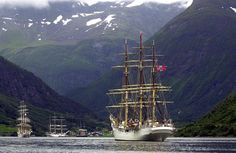 """July 17, 2001: The three famous Norwegian tall ships """"Christian Radich"""" (left), """"Statsraad Lemkuhl"""" and """"Sørlandet"""" (foreground) sailing into the Norangfjord,,,"""