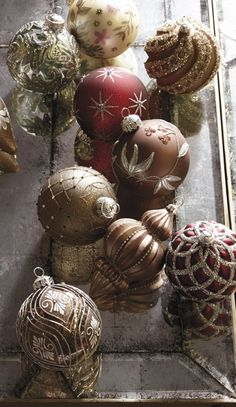 Ethereal and elegant, the Arabella collection's beads, crystals and faux pearls are a dazzling counterpoint to glass ornaments of cool platinum and creamy mocha, punctuated with rich cranberry notes.