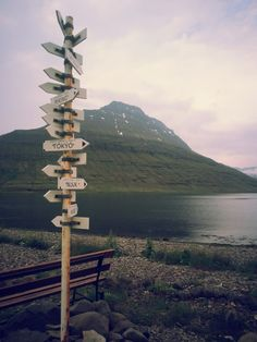 Where do you wanna go? A cool sign in Eskifjörður. The mountain Hólmatindur in the back