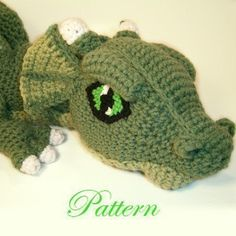*******This is a Crochet Pattern NOT a finished toy******* This Cuddly Dragon stands about 6 inches tall, has a wing span of about 25 inches, and is 33 inches from snout to tail. Would make a perfect gift for people of all ages. Dont be intimidated on how complex this dragon looks.