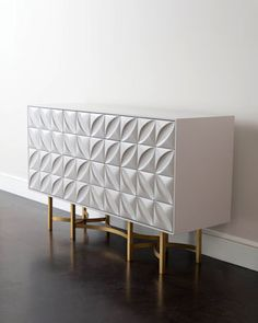 White modern petal design with bronze finish stand. John-Richard Collection Barrington Console