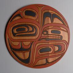 Red Cedar and acrylic raven transforming panel by salish artist Jim Charlie