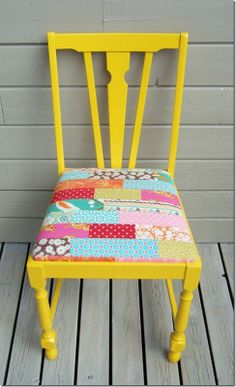 I have 2 old chairs from my grandfather. They are very weathered. I've already painted one a bright blue and the other will be bright yellow, like this one. They are uncomfortable to sit on - guess I'll now be digging through my fabric scraps to make removable quilted cushions.