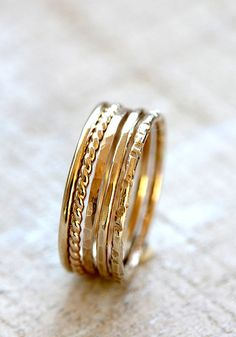Gold stacking rings. Solid 14k set of 5 gold stacking rings from Praxis Jewelry