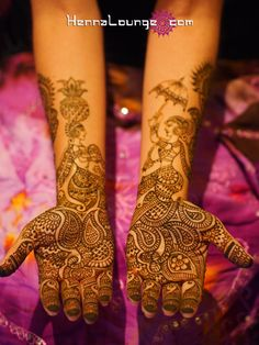 Figurative mehndi - two wedding guests, one sprinkling flowers, and the other carries an umbrella because of a rainy forecast. True story! :)