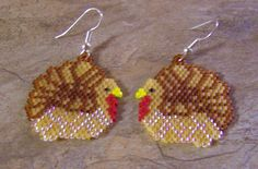These cute turkey earrings are done in the brick stitch with size 11 delica galss beads. The colors that I have used are root beer, light topaz yellow,