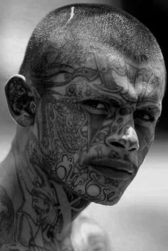 Tattoos - A Mara Salvatrucha (commonly abbreviated as MS, Mara, and MS-13) gang member. A transnational criminal gang that originated in Los Angeles and has spread worldwide. S)